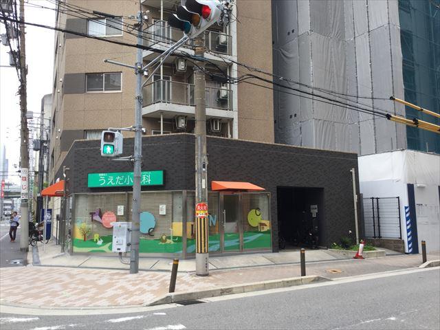 新築マンション「グランドメゾン立売堀一丁目」横に小児科